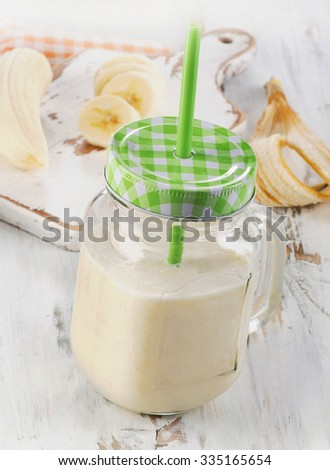 Healthy Banana smoothie on a wooden table. Selective focus
