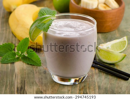 Healthy  Banana smoothie with lime . Selective focus