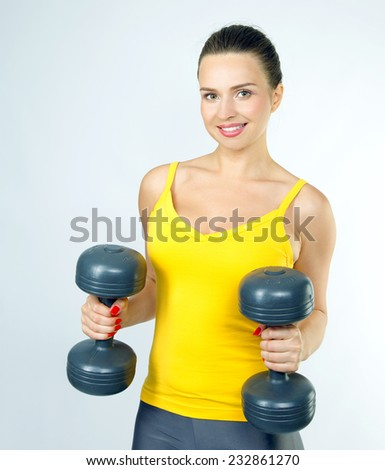 Healthy beautiful woman with dumbbells working out on white background. fitness gym concept