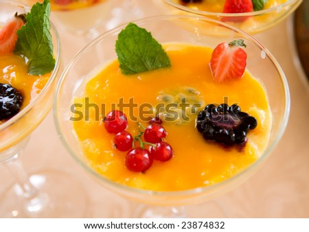 Healthy berry dessert - currant, blackberry and strawberry decorated with mint leaf