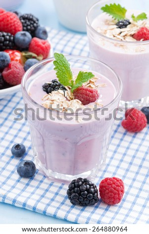 healthy berry smoothies with oatmeal, vertical, top view - stock photo
