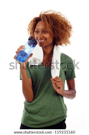 Healthy black woman with gym towel and water bottle isolated over white - stock photo