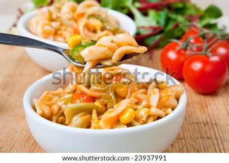 Healthy bowl of delicious pasta with salad
