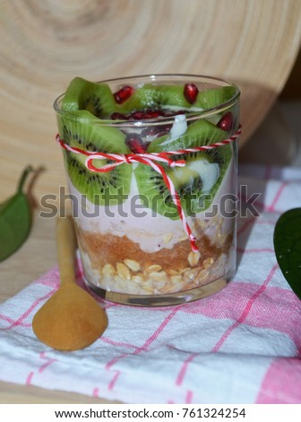 Healthy breakfast bowl with yoghurt, apple, pomegranate and kiwi