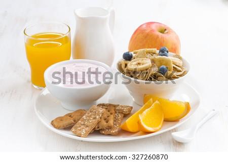 healthy breakfast - cereal, fruit, yogurt and juice, close-up, horizontal - stock photo