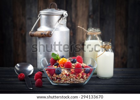 healthy breakfast, cereal with fresh fruit and milk - stock photo