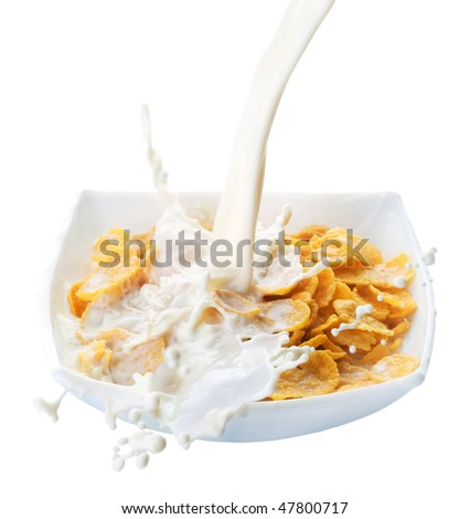 Healthy Breakfast-Cornflakes and Milk Splash.Isolated on white - stock photo