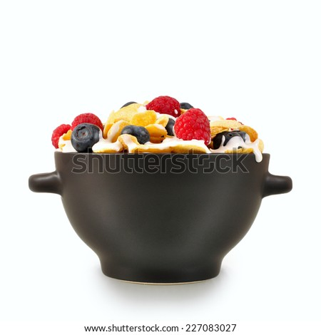 Healthy breakfast cornflakes with berries on a white background
