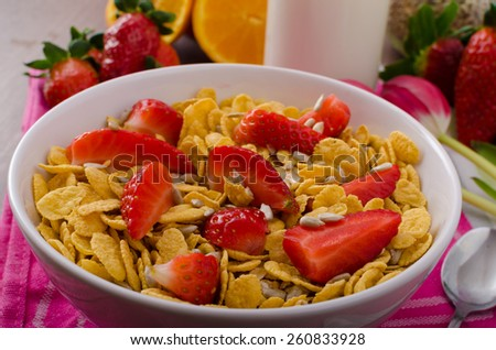 Healthy breakfast cornflakes with milk and strawberries, bio healthy, eat clean - stock photo