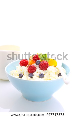healthy breakfast - cottage cheese with berries and yogurt. white background