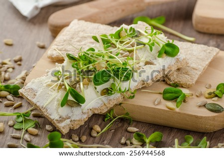 Healthy breakfast, Crispbread with organic cream cheese, microgreens and fresh from oranges