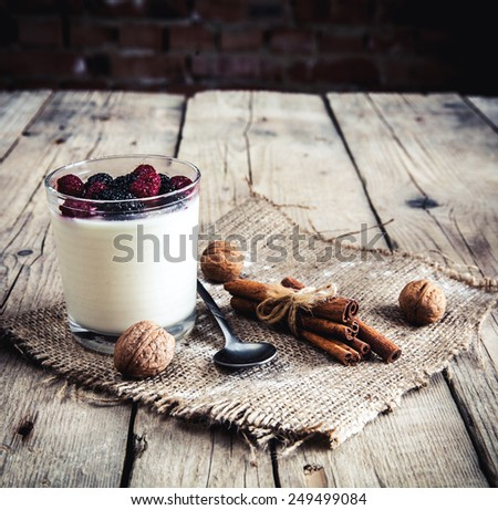 Healthy breakfast - Dairy yogurt with raspberry, mulberry on wooden background. Delicious food. dessert - stock photo