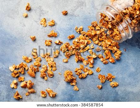 Healthy breakfast. Fresh granola, muesli in a glass jar Organic oat, almond and sunflower seeds Copy space - stock photo