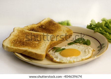 healthy breakfast fried egg yellow yolk, toast bread, sausage, vegetable in morning,  delicious sandwich diet lunch