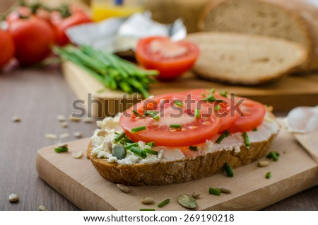 Healthy breakfast - homemade beer bread with cheese, tomatoes and chives - stock photo
