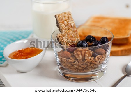 Healthy Breakfast. Muesli and Blueberry on White Wooden Table. Diet concept. - stock photo