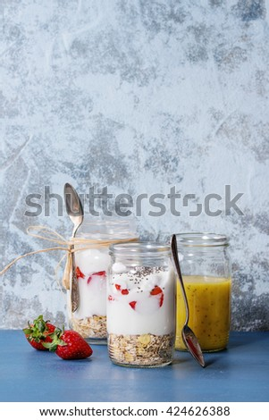 Healthy breakfast muesli, strawberries and yogurt with mango smoothie ...