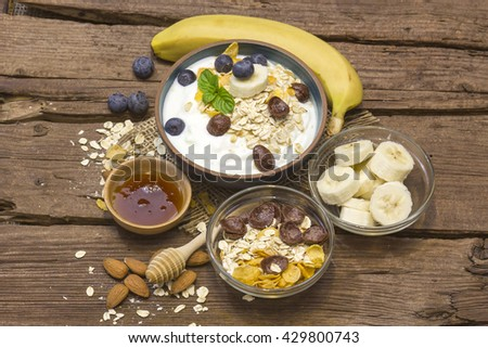 healthy breakfast - muesli with fruit, yogurt and honey