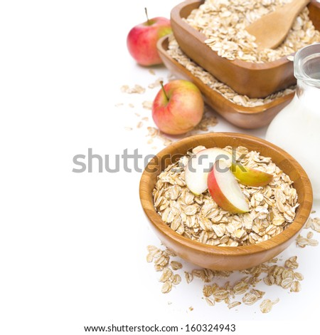 healthy breakfast - oat flakes with apples and a jug of milk, isolated on white