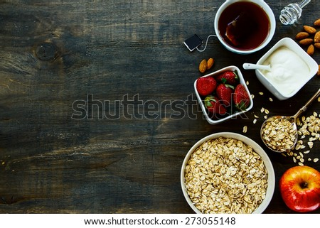 Healthy Breakfast. Oats, berries and tea. Health and diet concept. Top view. - stock photo