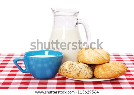Healthy breakfast on table with buns and milk