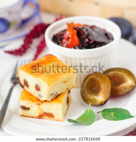 Healthy Breakfast: Slices of Cheesecake with Sultanas, Stoned Plums and Plum and Orange Jam, square - stock photo