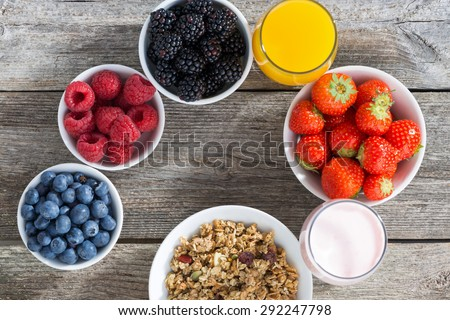 healthy breakfast with berries on wooden background, top view, horizontal - stock photo