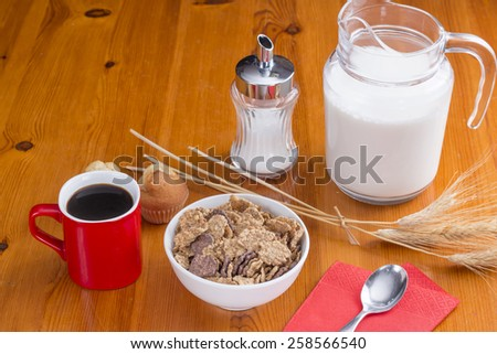 Healthy breakfast with cereals, coffee and cupcake - stock photo