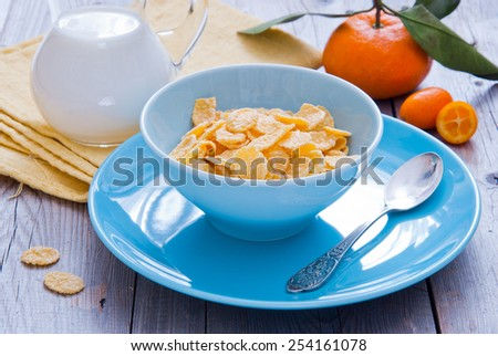 Healthy breakfast with corn flakes - stock photo