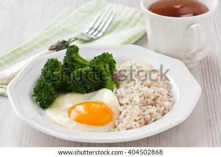 Healthy breakfast with egg, brown rice and broccoli/Healthy egg breakfast  - stock photo