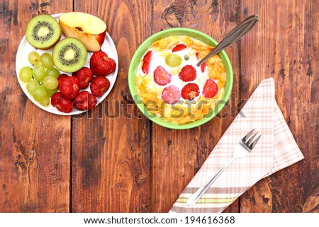 Healthy breakfast with fruit and cornflakes - stock photo