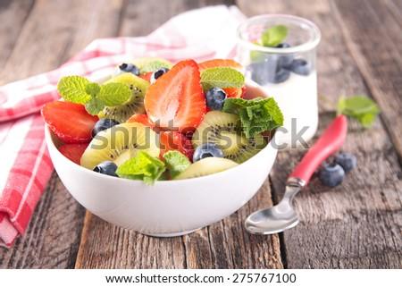 healthy breakfast with fruit and yogurt - stock photo