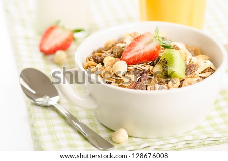 Healthy breakfast with muesli (cereal with fruits, berries, nuts) - stock photo