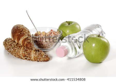healthy breakfast with muesli, green apple and wholegrain croissant - stock photo