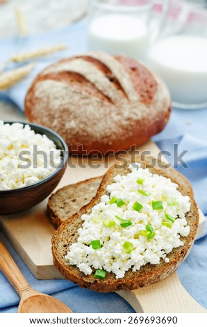 healthy Breakfast with whole grain rye bread, cottage cheese and milk. the toning. selective focus - stock photo