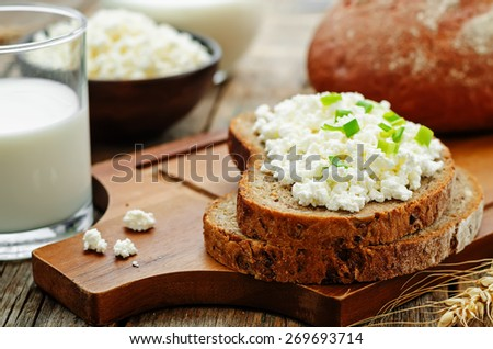 healthy Breakfast with whole grain rye bread, cottage cheese and milk. the toning. selective focus