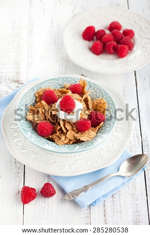 Healthy breakfast with wholegrain flakes, milk and fresh berries on white wooden background, selective focus - stock photo