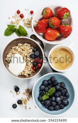 Healthy breakfast - yogurt with muesli and berries - health and diet concept - stock photo