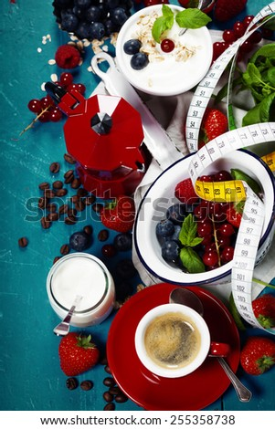 Healthy breakfast - yogurt with muesli and berries - health and diet concept. Blue background - stock photo