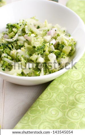 Healthy broccoli and cucumber salad with onion