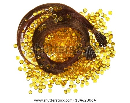 Healthy brown hair extensions strands and keratin glue beads isolated on white background - stock photo