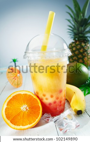 Healthy bubble tea tropical fruit smoothie with banana, mango, pineapple and orange blend - stock photo