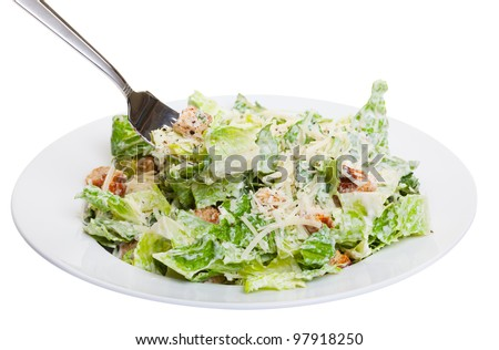 Healthy caesar salad isolated on white - stock photo