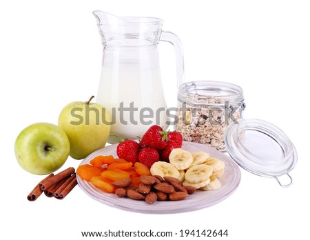 Healthy cereal with milk and fruits isolated on white - stock photo