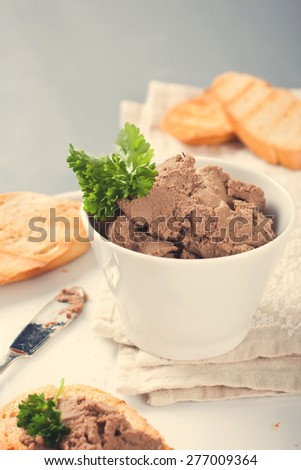Healthy chicken liver pate with parsley in bawl,  selective focus. Retro vintage instagram filter. - stock photo