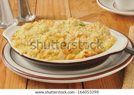 Healthy chicken rice casserole with vegetables, topped with bread crumbs - stock photo
