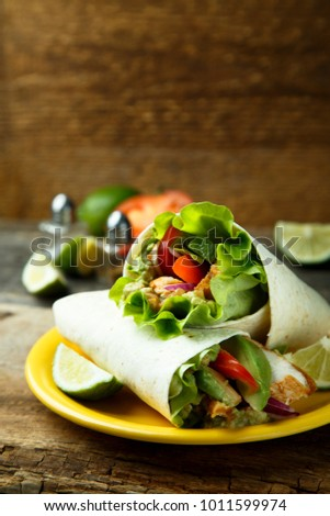 Healthy chicken wraps with avocado dip
