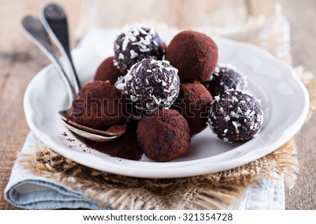 Healthy chocolate truffles with nuts and dates - stock photo