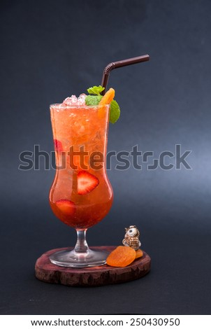 healthy cocktail  on wooden cutting board isolated on black background
