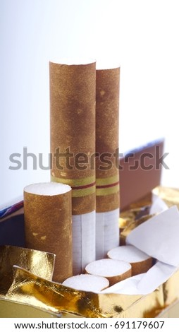 Healthy concept. Closeup of cigarettes on white background. Selective focus and crop fragment.